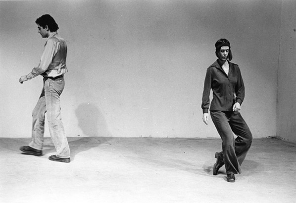 "Yvonne Rainer, ""Trio A,"" 1966. Performed as part of ""This is the story of a woman who…,"" Theater for the New City, New York, 1973. Performers : John Erdman and Yvonne Rainer."